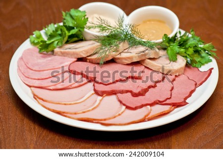 Group of thin sliced meat, ham and sauce - stock photo