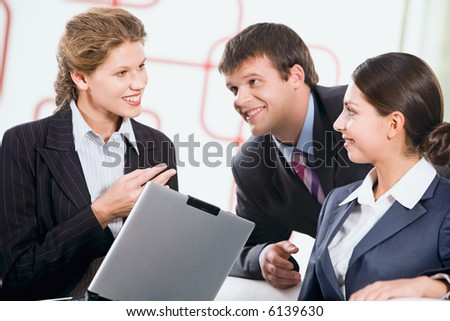 Group of three business people discussing a new plan - stock photo