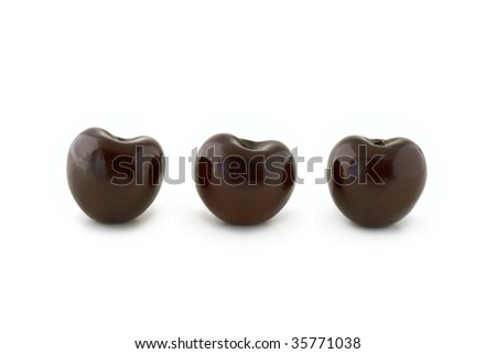 Group of three dark red cherries, without stalks, lined up. Isolated on white background, with shadow. - stock photo