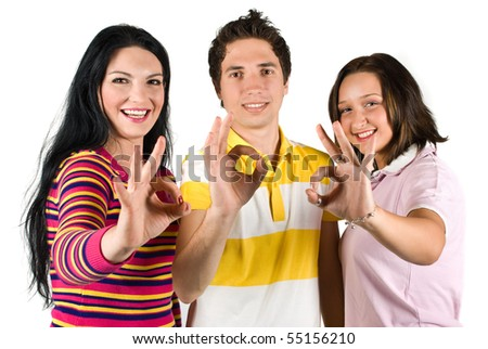 Group of three friends showing okay sign and laughing together isolated on white background