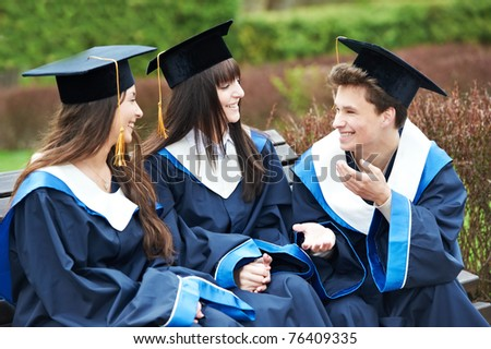 group of three graduation students in the park cheerful and happy - stock photo