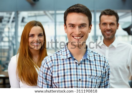 Group of three happy business coworkers - stock photo
