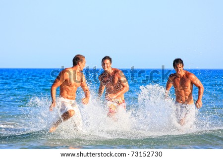 Group of three male friends having lots of fun in their vacation in Greece