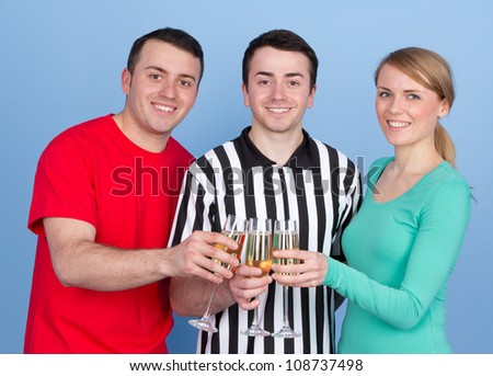 Group of three people celebrating after an event
