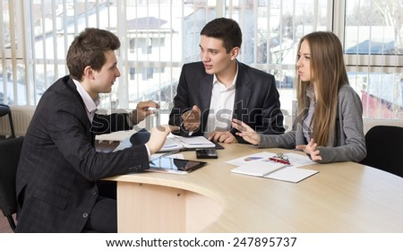 Group of three people having discussion.  Business people tries to convince each other making eloquent gestures