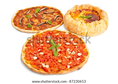 group of three pizzas: alla marinara with tomatoes and garlic, alla napoletana with anchovies, mozzarella and tomato sauce and chicago-style deep- dish stuffed pizza