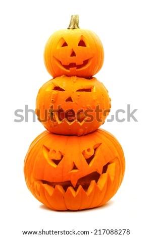 Group of three stacked Jack o Lanterns on a white background - stock photo