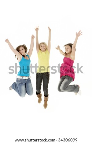 Group Of Three Young Girls Leaping In Air - stock photo