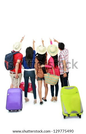group of tourist staying together and looking at above - stock photo