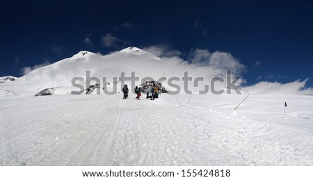 Group of tourists at Elbrus mountain - stock photo