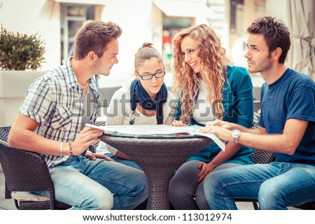 Group of Tourists Looking at Map - stock photo