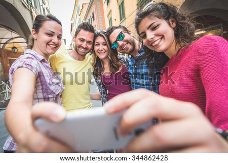 Group of tourists or friends taking a selfie in Pisa, Italy,  They are two men and three women. Lifestyle, friendship and travel concepts. - stock photo
