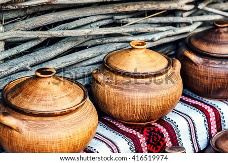 Group of traditional handmade pottery for sale at the market. Ukrainian handmade earthenware utensil. Souvenirs From Ukraine in ethnic style.  - stock photo