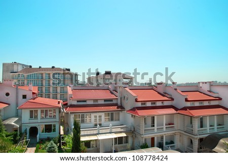 Group of traditional houses in the city with red tiled roofs - stock photo