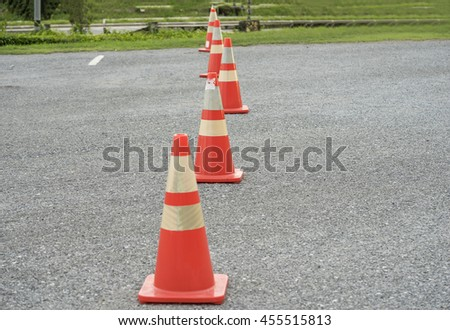 group of traffic cone on country street and green grass - can use to display or montage on product