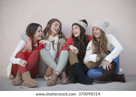 group of trendy happy teens smiling and laughing - stock photo