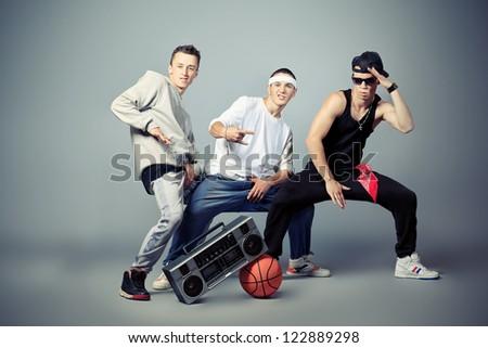 Group of trendy teenagers dancing hip-hop at studio. - stock photo