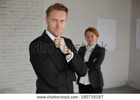 Group of two office workers posing for camera