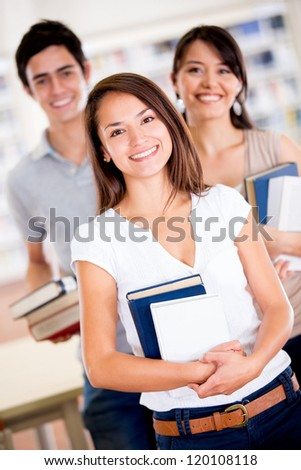 Group of university students at the library smiling