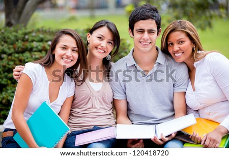 Group of university students outdoors looking happy - stock photo