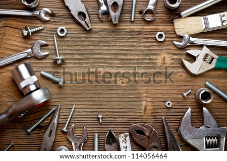 Group of used tools on wood background - stock photo