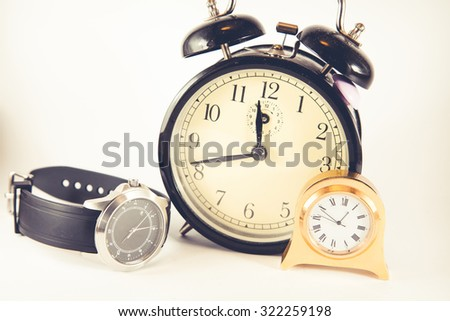 Group of various clocks with white background