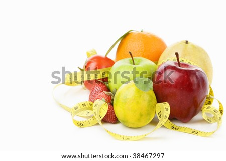 Group of various fruits with measuring tape over white background - stock photo