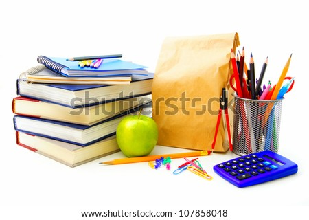 Group of various school supplies and items over a white background - stock photo