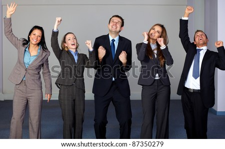 Group of 5 very happy and young business people, office shoot - stock photo
