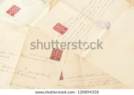 group of very old handwritten text agreements or contract - stock photo