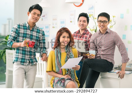 Group of Vietnamese creative team in smart casual wear