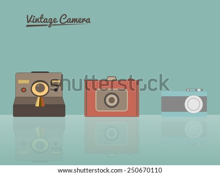 Group of vintage cameras against pastel background - stock photo