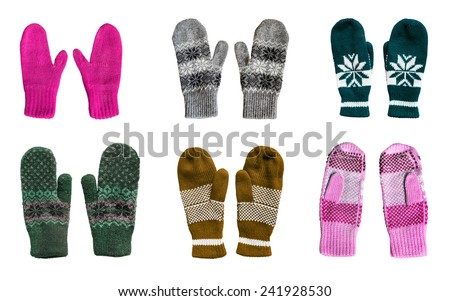 Group of warm knitted mittens isolated over white - stock photo