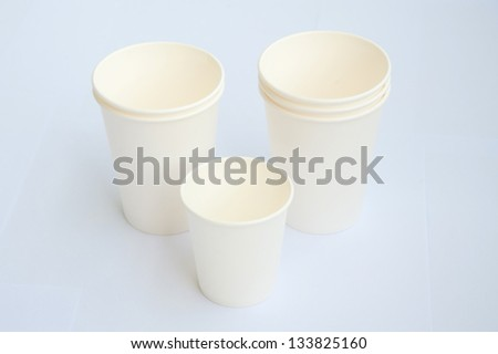 Group of white coffee cup made from cup stock paper on white background