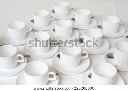Group of white coffee cups in cafe bar - stock photo