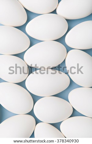 group of white eggs on blue background