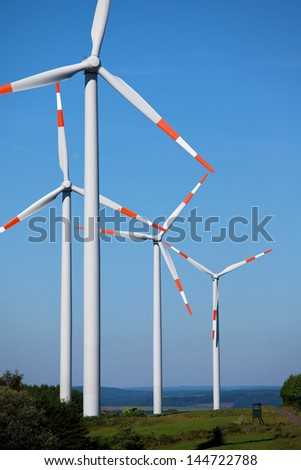 Group of wind turbines in the countryside - stock photo