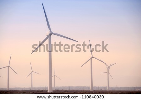 Group of Windmill in the sunset in western China - stock photo