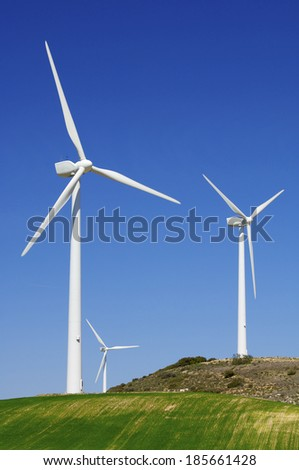 group of windmills for renewable electric energy production - stock photo