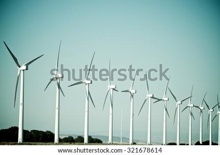 group of windmills for renewable electric energy production, Cintruenigo, Navarre, Spain - stock photo