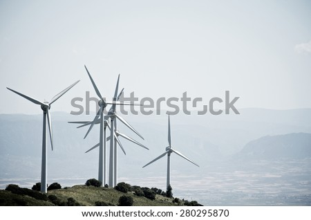 group of windmills for renewable electric energy production on a hill, Aras, Navarre, Spain - stock photo