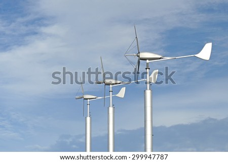 group of windmilsl for renewable energy with beautiful sky background