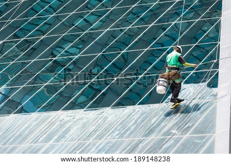 Group of window cleaners cleaning a high rise office building on a sunny day