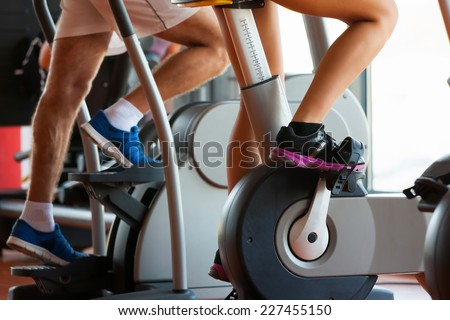 group of women and men - doing sport Spinning in the gym for fitness - stock photo