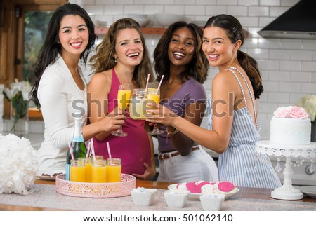 Group of women friends celebrating life love happiness friendship with cocktails mimosa brunch