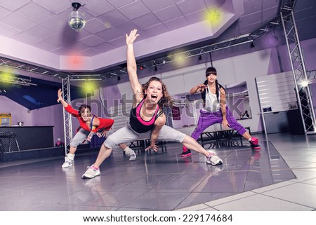 group of women in sport dress at fitness dance exercise or aerobics - stock photo