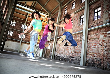 group of  women in sport dress dancing fitness dance or aerobics - stock photo