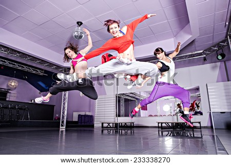 group of  women in sport dress jumping at fitness dance exercise or aerobics - stock photo