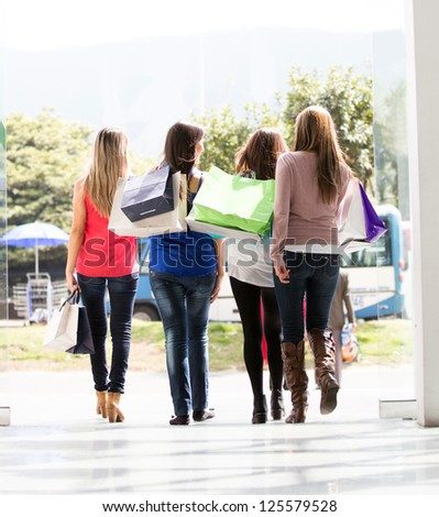 Group of women leaving the shopping center - stock photo