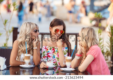 Group Of Women Meeting In Cafe. holidays, tourism, technology and internet - three beautiful girls. Three Women Enjoying Cup Of Coffee In Cafe.   - stock photo